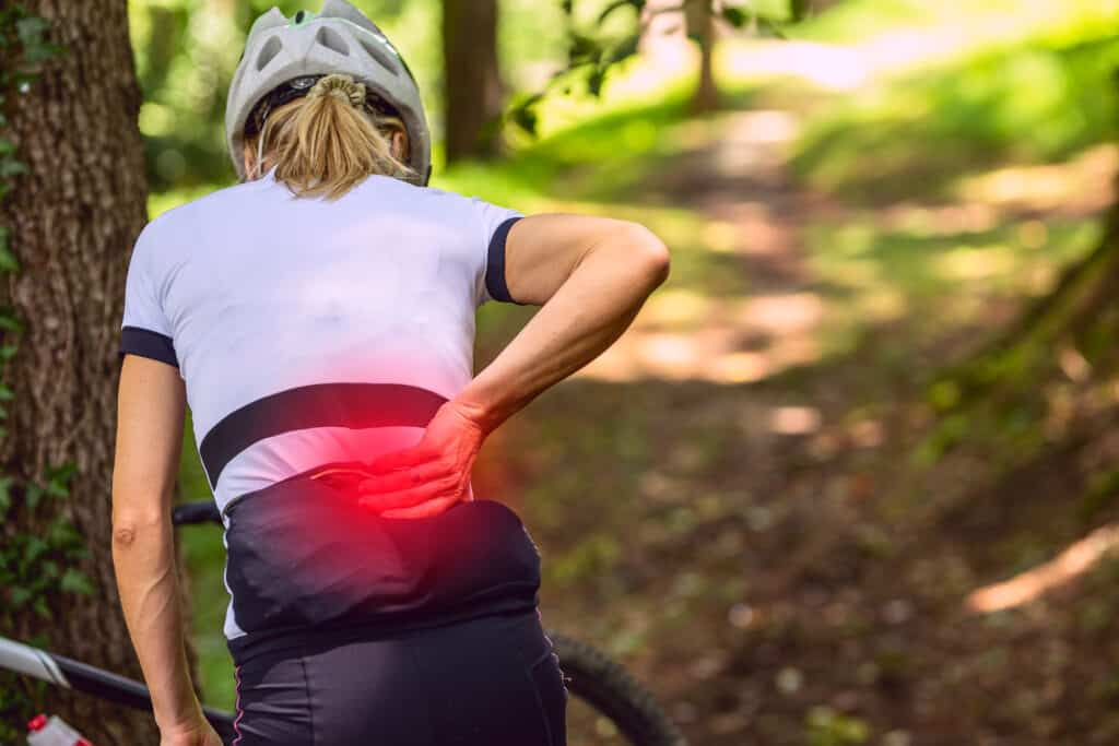 why do cyclists get back pain?